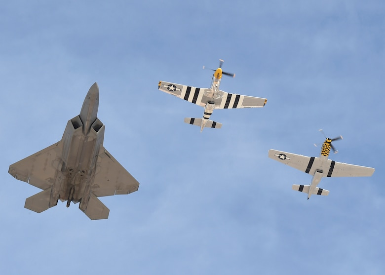 An F-22 Raptor and two P-51 Mustangs fly in formation during the Heritage Flight Training and Certification Course Feb. 9, 2017, at Davis-Monthan Air Force Base, Ariz. Heritage and demonstration teams need to be certified annually to participate in open houses and air shows worldwide. (U.S. Air Force photo by Senior Airman James Hensley)