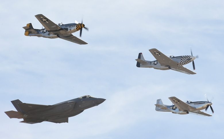 An F-35 Lightning II flies in formation with P-51 Mustangs during the Heritage Flight Training and Certification Course Feb. 9, 2017, at Davis-Monthan Air Force Base, Ariz. Heritage and demonstration teams need to be certified annually to participate in open houses and air shows worldwide. (U.S. Air Force photo by Senior Airman James Hensley)
