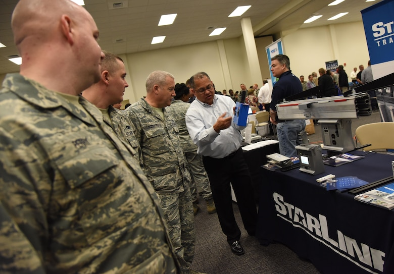 Johnny Gonzales, StarLine regional sales manager, gives an equipment brief on power monitoring to Keesler personnel during the 22nd annual Technology Expo at the Roberts Consolidated Aircraft Maintenance Facility Feb. 14, 2017, on Keesler Air Force Base, Miss. The 81st Communications Squadron hosted the free event open to all Defense Department, government and contractor personnel with base access. (U.S. Air Force photo by Kemberly Groue)