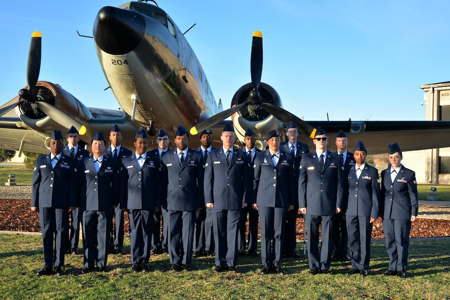 Airman leadership school class 17-B stands before a static plane display on Goodfellow Air Force Base, Texas, Feb, 15, 2017. ALS is a 6-week course designed to prepare senior airmen to assume supervisory duties, offering instruction in the practice of leadership and followership, written and oral communicative skills, and the profession of arms. (U.S. Air Force photo by Airman 1st Class Randall Moose/Released)