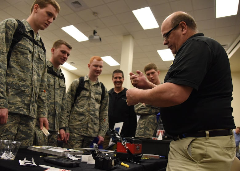 John DeMetro, FIS sales associate, provides a demonstration on fiber optic cable splicing during the 22nd annual Technology Expo at the Roberts Consolidated Aircraft Maintenance Facility Feb. 14, 2017, on Keesler Air Force Base, Miss. The 81st Communications Squadron hosted the free event open to all Defense Department, government and contractor personnel with base access. (U.S. Air Force photo by Kemberly Groue)