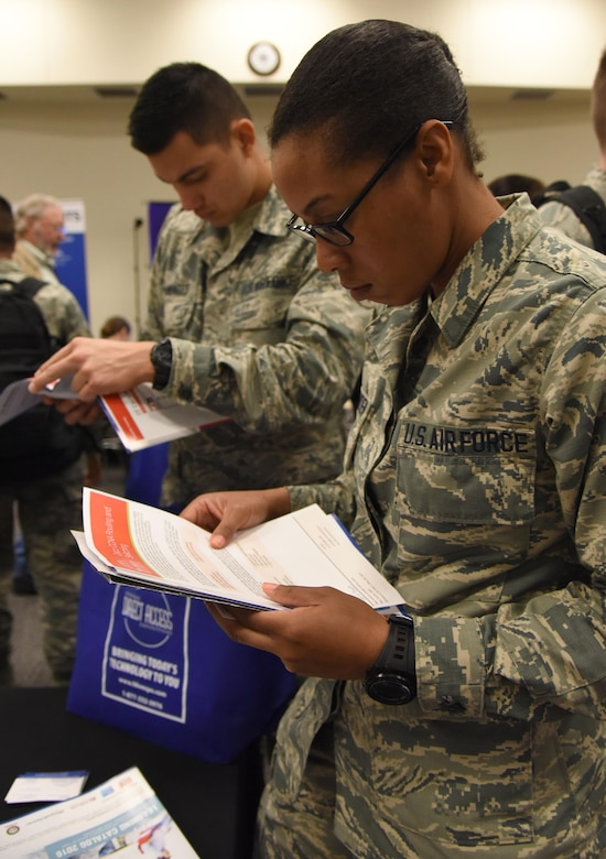 Airman 1st Class Kathryn Crittenden, 336th Training Squadron student, reviews a brochure during the 22nd annual Technology Expo at the Roberts Consolidated Aircraft Maintenance Facility Feb. 14, 2017, on Keesler Air Force Base, Miss. The 81st Communications Squadron hosted the free event open to all Defense Department, government and contractor personnel with base access. (U.S. Air Force photo by Kemberly Groue)