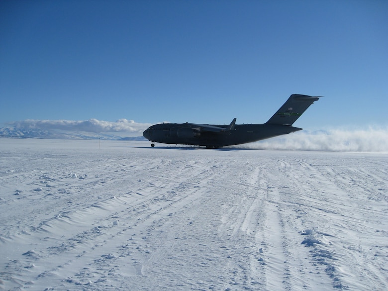 A McChord Air Force Base C-17 Globemaster III, a cargo and transport aircraft used by air forces around the world, takes flight from the new Antarctic deep-snow runway, the Phoenix, during a test run.