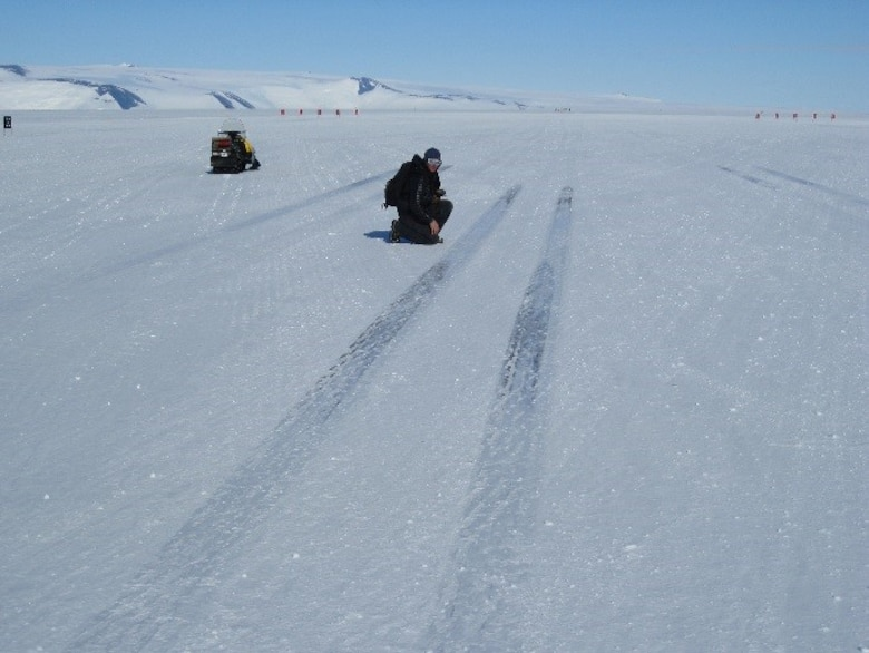 U.S. Army Engineer Research and Development Center's Terry Melendy recently measures aircraft wheel friction patterns between takeoffs and landings left by the heavy C-17s on the newly constructed Phoenix runway in Antarctica.
