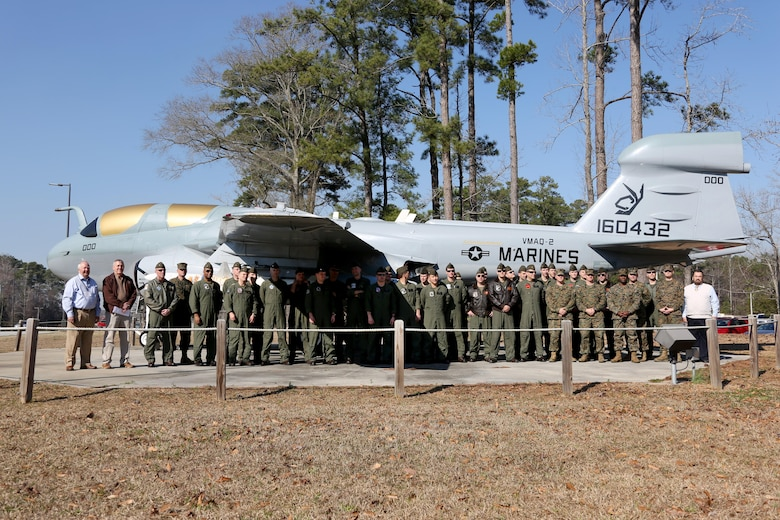 Marines assigned to various Marine Tactical Electronic Warfare Squadrons come together in honor of the 40th anniversary of the EA-6B Prowler during a commemoration ceremony held aboard Marine Corps Air Station Cherry Point, N.C., Feb. 17, 2017. The primary mission of the Prowler is suppression of enemy air defenses in support of strike aircraft and ground troops by interrupting enemy electronic activity and obtaining tactical electronic intelligence within the combat area. The VMAQ squadrons will be operating until their sundown in 2019 when the final Prowler will be transitioned out of the Marine Corps.  (U.S. Marine Corps photo by Cpl. Jason Jimenez/ Released)