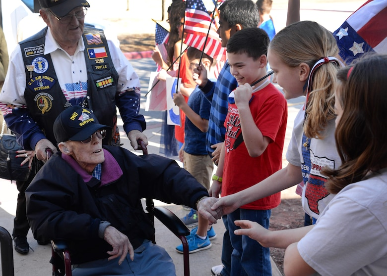 Iwo Jima survivors are greeted by children on Sheppard Air Force Base, Texas, Feb. 17, 2017. Children from Sheppard Elementary School met with WWII veterans during the Iwo Jima survivors 72nd Reunion. (U.S. Air Force photo by Senior Airman Robert L. McIlrath/Released)