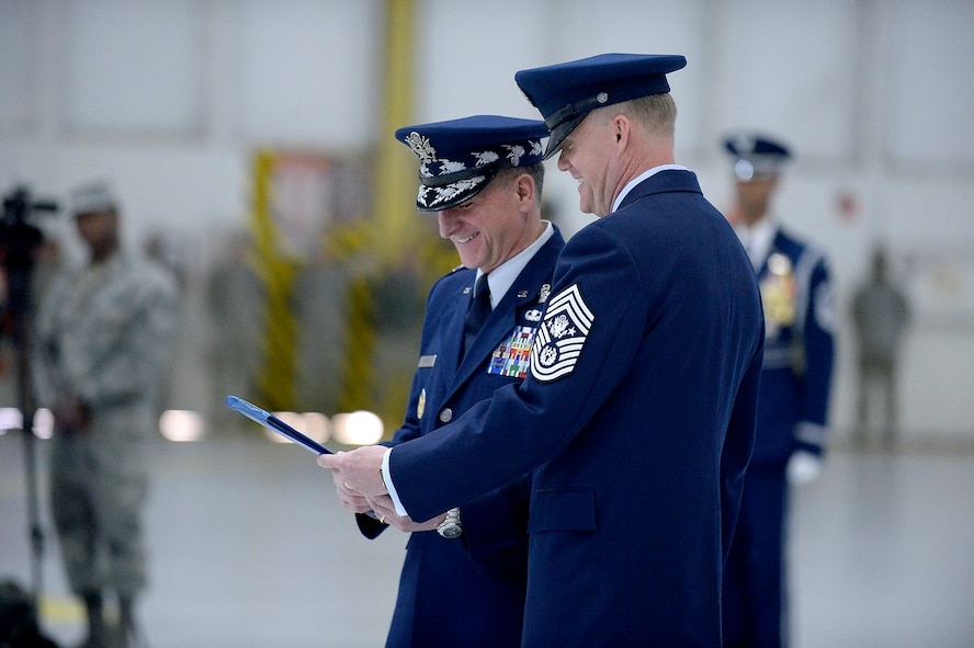 Air Force Chief of Staff Gen. David L. Goldfein retires Chief Master Sgt. of the Air Force James A. Cody during a retirement and appointment ceremony on Joint Base Andrews, Md., Feb. 17, 2017. Cody retires after 32 years of service and is succeeded by Chief Master Sgt. of the Air Force Kaleth O. Wright, the 18th Airman to hold this position. (U.S. Air Force photo/Andy Morataya)