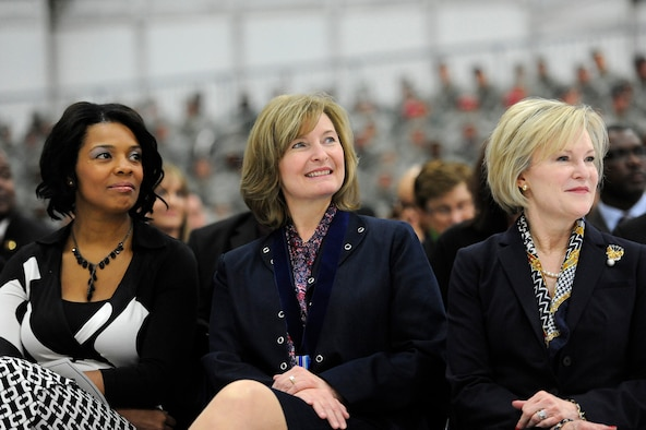 Athena Cody, center, smiles while her husband, Chief Master Sgt. of the Air Force James A. Cody, retires during a retirement and appointment ceremony on Joint Base Andrews, Md., Feb. 17, 2017. Cody retires after 32 years of service and is succeeded by Chief Master Sgt. of the Air Force Kaleth O. Wright, the 18th Airman to hold this position. With Athena Cody are Tonya Wright, left, wife of Chief Master Sgt. of the Air Force Kaleth O. Wright, and Dawn Goldfein, right, wife of Air Force Chief of Staff David L. Goldfein.  (U.S. Air Force photo/Tech. Sgt. Robert Barnett)