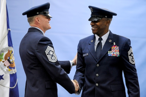 Chief Master Sgt. of the Air Force James A. Cody congratulates his successor, Chief Master Sgt. of the Air Force Kaleth O. Wright, during their retirement and appointment ceremony on Joint Base Andrews, Md., Feb. 17, 2017. Wright succeeds Chief Master Sgt. of the Air Force James A. Cody, who retires after 32 years of service, and he is the 18th Airman to hold this position. (U.S. Air Force photo/Tech. Sgt. Robert Barnett)
