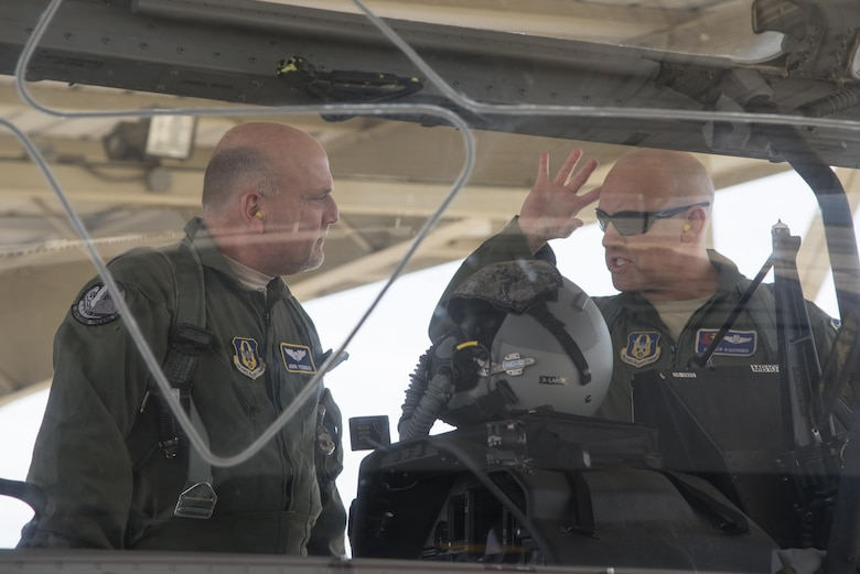 John Fedrico (L), deputy assistant Secretary of the Air Force for Reserve Affairs and Airman Readiness receives a flight line briefing from Lt. Col. Andrew Kissinger (39 FTS) prior to his T-6 orientation flight during a visit to Joint Base San Antonio-Randolph, Texas on Feb. 13. Fedrico's visit, hosted by the 340 FTG, served a dual purpose. Fedrico presented a letter of thanks to one of the unit's own, retired Air Force Lt. Col. Todd Ernst, for his efforts to help ensure families of Reserve and Guard service members receive the same survivor benefits as active duty service members. Fedrico also received a mission brief and got to experience the unit's operations first hand. (Air Force photo by Sean Worrell, Joint Base San Antonio-Randolph Public Affairs)