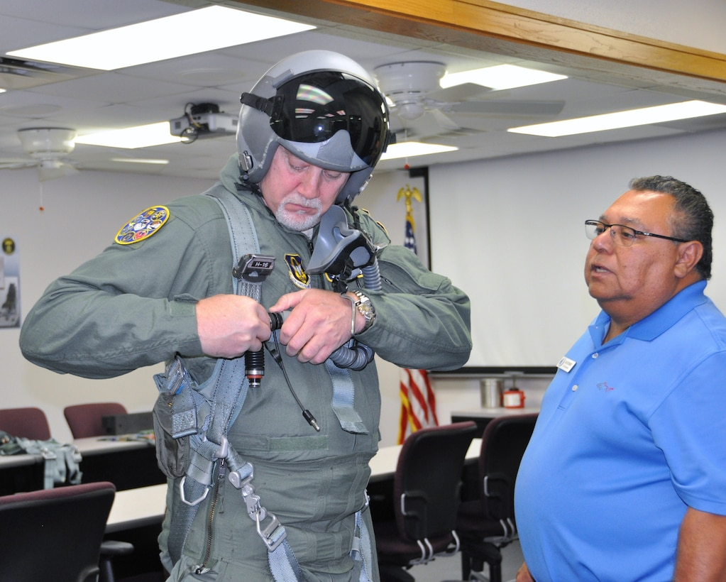 Ray Gutierrez, flight equipment life support technicians with the 559 Flying Squadron at Joint Base San Antonio-Randolph, Texas, makes final G-suit adjustments for John Fedrico, deputy assistant Secretary of the Air Force for  Reserve Affairs and Airman Readiness in preparation for a T-6 orientation flight here Feb. 13. Fedrico's visit, hosted by the 340 FTG, served a dual purpose. Fedrico presented a letter of thanks to one of the unit's own, retired Air Force Lt. Col. Todd Ernst. Ernst was honored for his efforts to help ensure families of Reserve and Guard service members receive the same survivor benefits as active duty service members. Fedrico also received a mission brief and got to experience the unit's operations first hand. (Air Force photo by Janis El Shabazz, 340 FTG Public Affairs)
