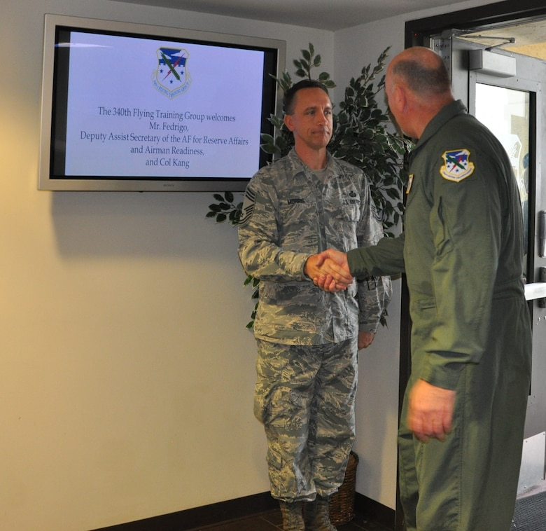 340th Flying Training Group Superintendent, Chief Master Sgt. Jimmie Morris, greets John Fedrico, deputy assistant Secretary of the Air Force for  Reserve Affairs and Airman Readiness, during his visit here Feb. 13. Fedrico presented a letter of thanks to one of the unit's own, retired Air Force Lt. Col. Todd Ernst. Ernst was honored for his efforts to help ensure families of Reserve and Guard service members receive the same survivor benefits as active duty service members. Fedrico also received a mission brief and got to experience the unit's operations first hand. (Air Force photo by Janis El Shabazz, 340 FTG Public Affairs)