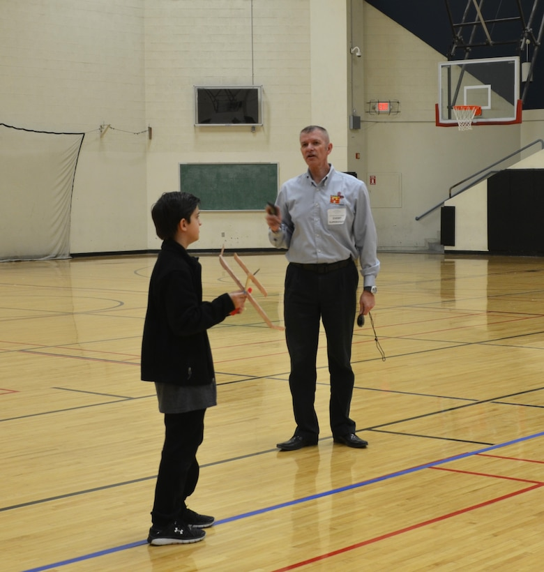 ALBUQUERQUE, N.M. – Wright Stuff event judge Reginald Bourgeois, right, gives last minute instructions to Cottonwood Classical Prep School student Ty Webster, before he launches his plane, Jan. 28, 2017.