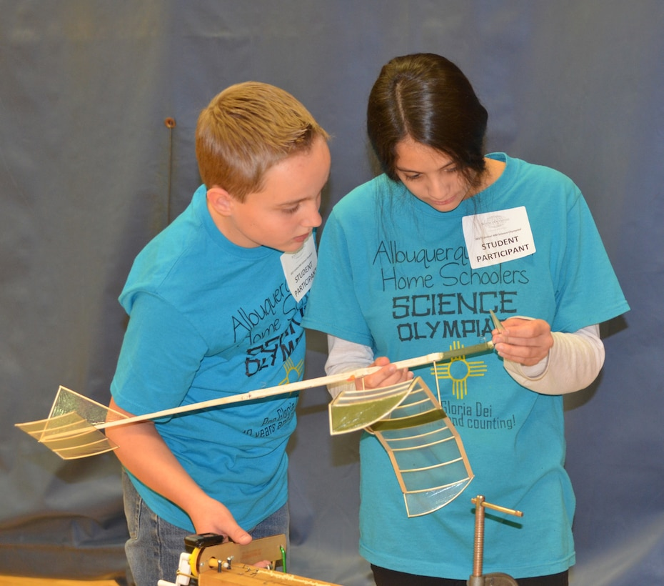 ALBUQUERQUE, N.M. – Steven Johnson and Brianna Ulibarri, both with the Albuquerque Area Homeschoolers, make a final check of their plane before competing in the Wright Stuff event at the 2017 Central New Mexico Science Olympiad, Jan. 28, 2017.
