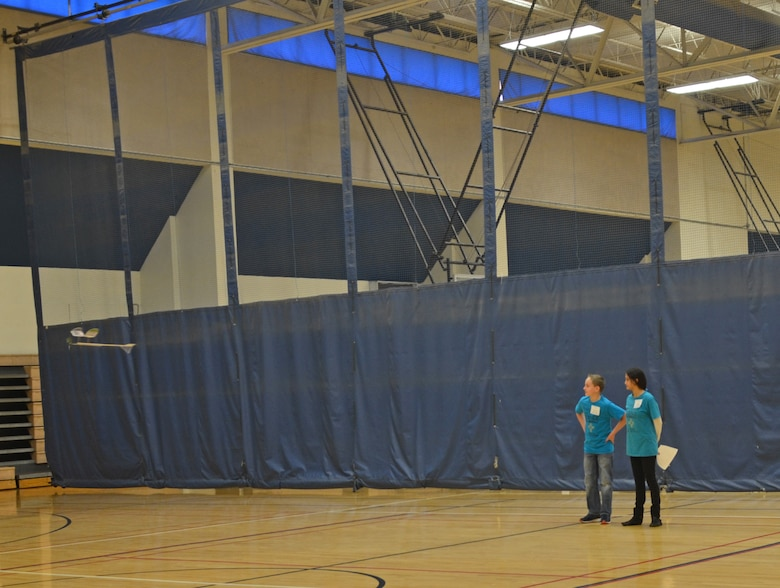 ALBUQUERQUE, N.M. – Steven Johnson and Brianna Ulibarri, both with the Albuquerque Area Homeschoolers, watch their plane as it flies around the gymnasium during the Wright Stuff event, Jan. 28, 2017.