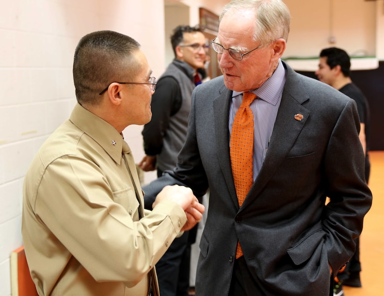 U.S. Marine Corps Director of Intelligence, Brig. Gen. William H. Seely III, shows his Oklahoma State University graduation ring to Burns Hargis, President of OSU near Gallagher-Iba Arena, Feb. 15. Seely also had the opportunity to speak to the number one ranked Cowboys wrestling team.