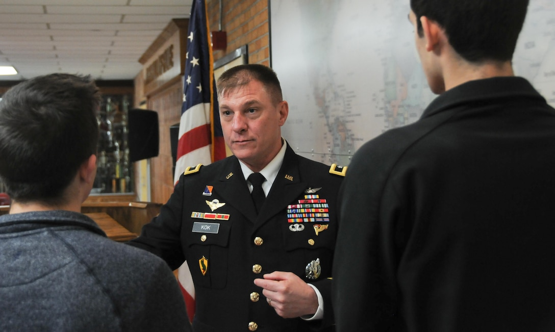 Maj. Gen. Troy D. Kok, commanding general of the U.S. Army Reserve's 99th Regional Support Command, left, engages with students following his induction into the Allentown High School Hall of Fame Feb. 17 during a ceremony at the school. Kok's command is headquartered at Joint Base McGuire-Dix-Lakehurst and his area of responsibility includes 44,000 Army Reserve Soldiers throughout the 13 northeastern states.