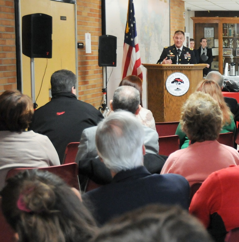 Maj. Gen. Troy D. Kok, commanding general of the U.S. Army Reserve's 99th Regional Support Command, left, is inducted into the Allentown High School Hall of Fame Feb. 17 during a ceremony at the school. Kok's command is headquartered at Joint Base McGuire-Dix-Lakehurst and his area of responsibility includes 44,000 Army Reserve Soldiers throughout the 13 northeastern states.