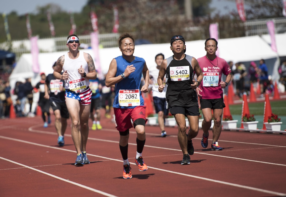 Marathon runners sprint to the finish line of the Okinawa Marathon Feb. 19, 2017, at the Okinawa Prefectural Comprehensive Park in Okinawa, Japan. This year marks the 25th anniversary of the Okinawa Marathon and the 25th year that Kadena AB has supported the race. (U.S. Air Force photo by Senior Airman Omari Bernard/Released)