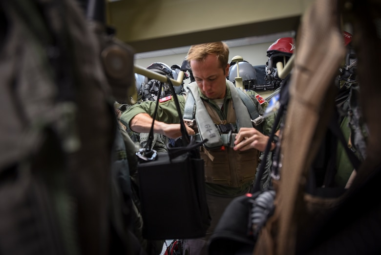U.S. Air Force Capt. Chris Dubois, 67th Fighter Squadron F-15 Eagle pilot, prepares for flight during annual exercise Cope North Feb. 20, 2017, at Andersen Air Force Base, Guam. The equipment is maintained and inspected by Airmen from the 18th Operations Support Squadron, who ensure life-saving gear will work properly in the event of an emergency. (U.S. Air Force photo by Senior Airman John Linzmeier/released)