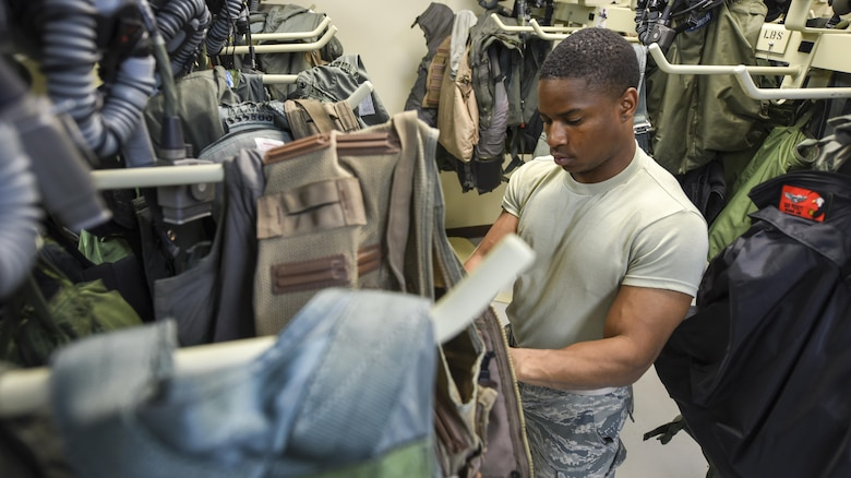 U.S. Air Force Airman Rashad Kelley, 18th Operations Support Squadron aircrew flight equipment technician, prepares flight equipment for use Feb. 20, 2017, at Andersen Air Force Base, Guam. Kelley and other 18th OSS Airmen traveled with the 67th Fighter Squadron from Kadena Air Base, Japan, to participate in Cope North, an annual exercise designed to increase interoperability between the U.S, Japan and Australian air forces. Aircrew flight equipment Airmen support aircrew members from various airframes to aid combat operations. (U.S. Air Force photo by Senior Airman John Linzmeier/released)