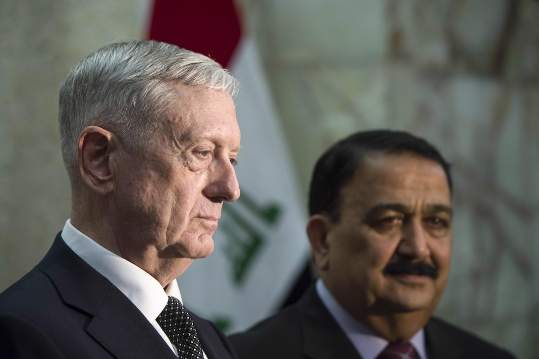 Defense Secretary Jim Mattis, left, meets with Iraqi Minister of Defense Arfan al-Hayali at the Ministry of Defense in Baghdad, Iraq.