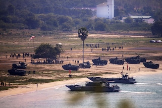 Amphibious assault vehicles carrying U.S., South Korean and Thai troops come ashore during Exercise Cobra Gold at Hat Yao, Rayong province, Thailand, Feb. 17, 2017. Marine Corps photo by Sgt. Akeel Austin