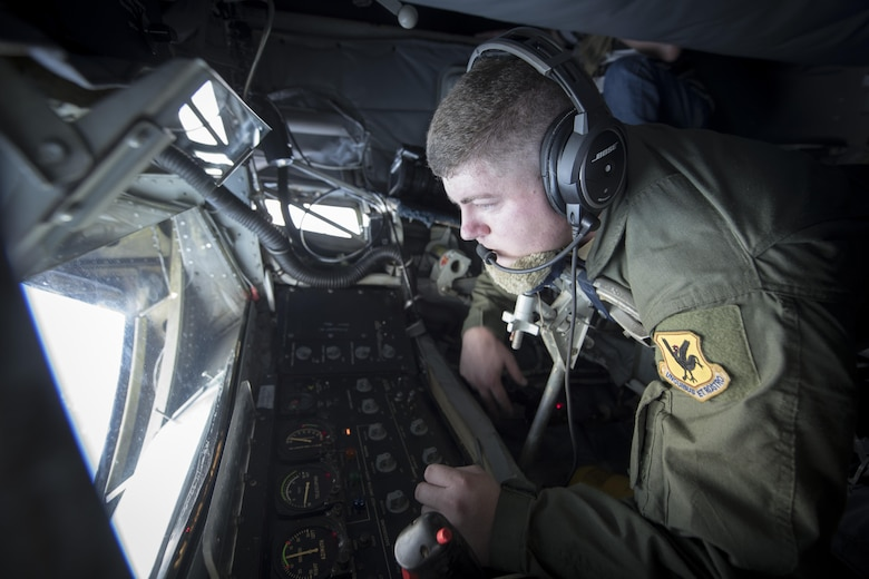 U.S. Air Force Staff Sgt. Michael Voorhees, 909th Air Refueling Squadron instructor boom operator, prepares to conduct in-flight refueling aboard a KC-135 Stratotanker Feb, 21, 2017, off the coast of Guam. Twenty-two flying units, including the 909th ARS, are on Andersen Air Force Base to participate in annual exercise Cope North. Boom operators have the ability to pump thousands of pounds of fuel to any capable aircraft while thousands of feet above the ground. (U.S. Air Force photo by Senior Airman John Linzmeier/released)