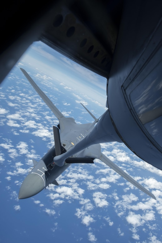 A U.S. Air Force B-1B Lancer assigned to the 9th Expeditionary Bomb Squadron receives fuel from a 909th Air Refueling Squadron KC-135 Stratotanker during annual exercise Cope North, Feb. 21, 2017. The 909th ARS's motto is 'Always There,' symbolizing the squadron's constant presence and devotion to support allies and partners throughout the Indo-Asia Pacific. (U.S. Air Force photo by Senior Airman John Linzmeier/released)