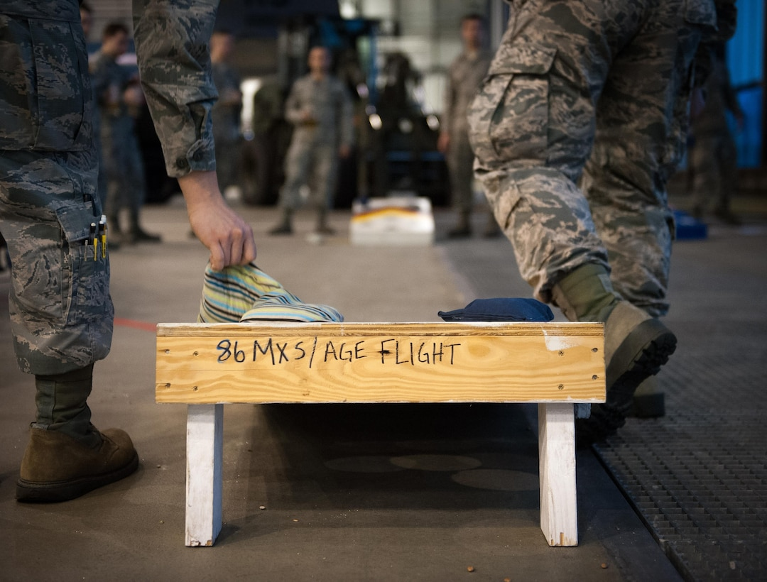 Airmen from the 86th Maintenance Squadron take part in team building before the 2016 Maintenance and Logistics Airmen Annual Award Ceremony on Ramstein Air Base, Germany, Feb. 17, 2017. The awards brought together Airmen within the maintenance and logistics career fields and rewarded the hardest-working ones with annual awards. (U.S. Air Force photo by Senior Airman Lane T. Plummer)