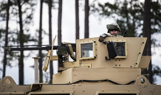 Airman Kyle Regal, 822d Base Defense Squadron fireteam member, waits in the turret of a Mine Resistant-Ambush Protected Vehicle before going on a patrol during a Full Mission Profile exercise, Feb. 15, 2017, at Moody Air Force Base, Ga. The 822d BDS is completing training exercises that will gradually increase in difficulty each week to prepare for an upcoming Mission Readiness exercise. The FMP enhanced training by increasing the complications and dangers of scenarios that challenged Airmen on simulated patrols. The exercise also pushed leadership in the Tactical Operation Center to successfully guide the Airmen through the challenges. (U.S. Air Force photo by Airman 1st Class Janiqua P. Robinson)