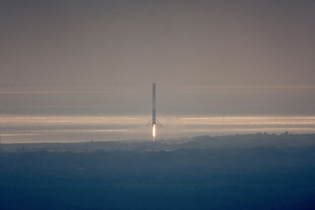 SpaceX Falcon 9's 1st stage booster on Space Launch Complex 13 after landing at Cape Canaveral Air Force Station Feb. 19, 2017. The booster landed minutes after the successful launch of the Falcon 9 carrying the 10th commercial resupply mission to the International Space Station. (Courtesy photo/SpaceX)