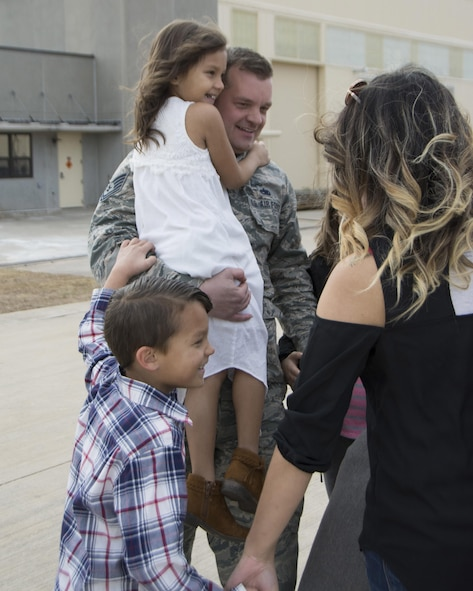 Tech. Sgt. Jonathan Brem of the 507th Maintenance Squadron reunites with his family following a deployment Feb. 17, 2017, at Tinker Air Force Base, Okla. More than 90 other Reservists deployed in December 2016 in support of air operations at Incirlik Air Base, Turkey, against the Islamic State group. (U.S. Air Force photo/Tech. Sgt. Lauren Gleason)