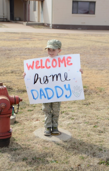 Aiden Teague holds a sign while waiting for his father, Senior Airman Kevin Teague of the 507th Aircraft Maintenance Squadron, to come from a deployment Feb. 19, 2017, at Tinker Air Force Base, Okla. More than 90 Reservists deployed in December 2016 in support of air operations at Incirlik Air Base, Turkey, against the Islamic State group. (U.S. Air Force photo/Tech. Sgt. Lauren Gleason)