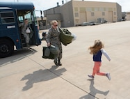 Staff Sgt. Morgan Marriott of the 507th Maintenance Squadron opens her arms to greet her daughter following a deployment Feb. 19, 2017, at Tinker Air Force Base, Okla. More than 90 Reservists deployed in December 2016 in support of air operations at Incirlik Air Base, Turkey, against the Islamic State group. (U.S. Air Force photo/Tech. Sgt. Lauren Gleason)