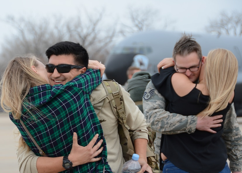 Staff Sgt. Adrian Condit of the 507th Aircraft Maintenance Squadron and Staff Sgt. Mykal Short of the 507th Maintenance Squadron embrace their family members following a deployment Feb. 19, 2017, at Tinker Air Force Base, Okla. More than 90 Reservists deployed in December 2016 in support of air operations at Incirlik Air Base, Turkey, against the Islamic State group. (U.S. Air Force photo/Tech. Sgt. Lauren Gleason)