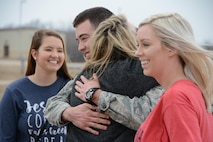 Senior Airman Tyler Franz of the 507th Operations Support Squadron hugs his family members following a deployment Feb. 19, 2017, at Tinker Air Force Base, Okla. Franz was awarded the 507th Air Refueling Wing Airman of the Year award for 2016 while he was deployed. More than 90 Reservists deployed in December 2016 in support of air operations at Incirlik Air Base, Turkey, against the Islamic State group. (U.S. Air Force photo/Tech. Sgt. Lauren Gleason)