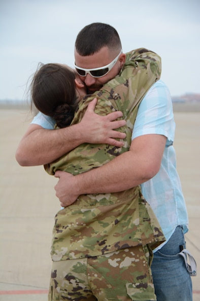 Senior Airman Brandy Hill of the 465th Air Refueling Squadron hugs her husband, Raymond, following a deployment Feb. 19, 2017, at Tinker Air Force Base, Okla. More than 90 Reservists deployed in December 2016 in support of air operations at Incirlik Air Base, Turkey, against the Islamic State group. (U.S. Air Force photo/Tech. Sgt. Lauren Gleason)