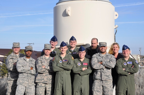The 20th Air Force Olympic Sword team pose for a group photo at Hill Air Force Base, Utah., Feb. 17, 2017. The team of missile combat operators, missile maintainers and Technical Order Management Agency office members spent three weeks improving the two main technical orders used by missileers who operate the Minuteman III weapon system. (U.S. Air Force photo by 1st Lt. Veronica Perez)