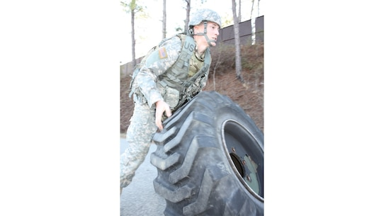 Spc. Christopher Childress with the 1184th Deployment and Distribution Support Battalion, Mobile, Alabama rolls a large tire end over end during one of the last events of this year's Best Warrior competition hosted by the Deployment Support Command at Fort Benning, Georgia. The winners of this competition will go on to compete in the 377th Theater Support Command's Best Warrior Competition beginning April 9 at Joint Base McGuire Dix Lakehurst, New Jersey.
