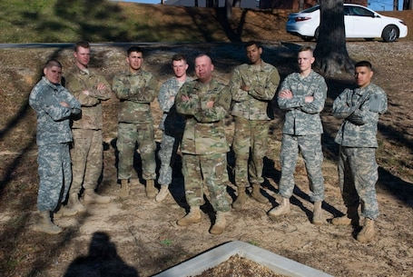 Competitors in the Deployment Support Command's 2017 Best Warrior Competition held at Fort Benning, Georgia huddle around Command Sgt. Maj. John K. Zimmerman after a long day navigating an obstacle course. Soldiers are selected to represent their home unit in this annual competition. The winner will move on to compete at the 377th Sustainment Support Command's competition and those winners will compete in the US Army Reserve competition. From there winners go to the All Army competition. From left: Sgt. Kevin Santiago a native of Porto Rico with the 757th Expeditionary Rail Center based in St. Louis, Missouri; Sgt. Brian Sonntag form Sonoma, California with the 1397th Deployment and Distribution Support Battalion, Mare Island in Vallejo, California; Private 1st Class Marco Mata with the 639th Transportation Detachment/1397th Deployment and Support Battalion, Mare Island in Vallejo, California; Spec. John Moore of Corpus Christi, Texas with the 370th Transportation Detachment out of  Sinton, Texas; Spec. Joshua Thomas from Chicago, Illinois with the 757th Expeditionary Rail Center at Fort Sheridan, Illinois; Spec. Christopher Childress from Gulf Shores, Alabama with the 1184th Deployment and Distribution Support Battalion, Mobile, Alabama; Private 1st Class David Ortiz from Brooklyn, New York of the 652nd Transportation Detachment out of Fort Totten, New York; and center, Command Sgt. Maj. John K. Zimmerman of the Deployment Support Command based in Birmingham, Alabama.