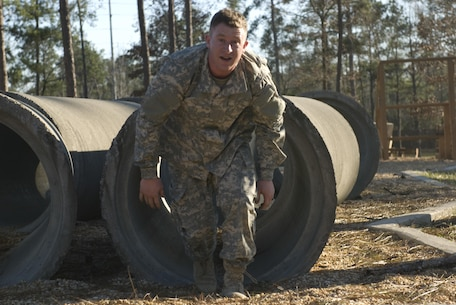 Spc. John Moore of Corpus Christi, Texas with the 370th Transportation Detachment out of Sinton, Texas exits the tunnel crawl obstacle at Fort Benning, Georgia. The obstacle course is just one of the events Soldiers competed in during the Deployment Support Command's 2017 Best Warrior Competition. The annual competition pits Soldier against Soldier to earn the privilege of representing the Deployment Support Command at the next level of competition and eventually in the All Army Best Warrior Competition.