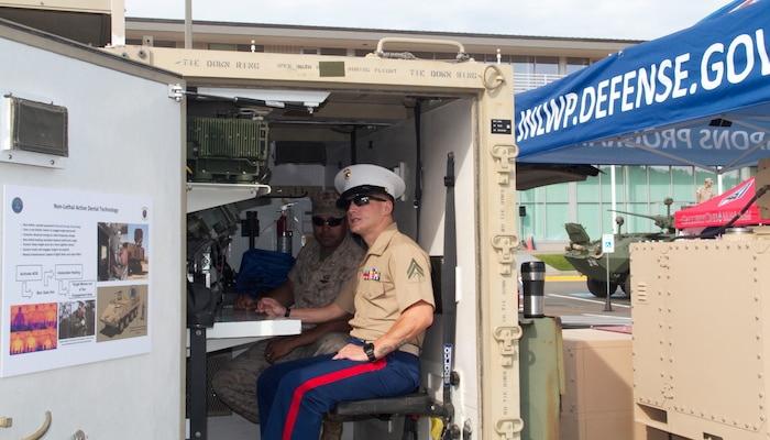 Cpl. Kyle Carpenter gets an inside look at the state-of-the-art technologies on display at the Museum of Flight during Marine Week Seattle. The Medal of Honor recipient talks to Capt Stephenson John about the Active Denial System (ADS). The ADS is an advanced, long-range, non-lethal, directed energy, counter-personnel capability that assists in minimizing civilian casualties and collateral damage.