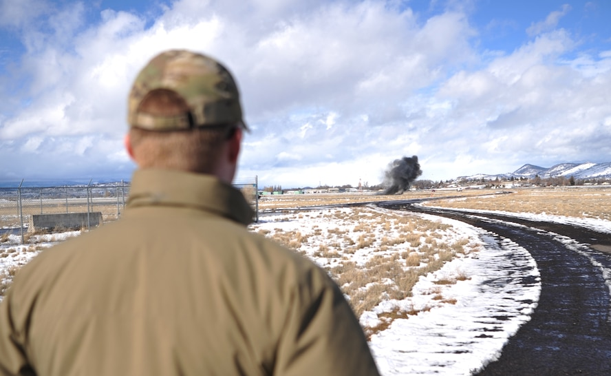 Airman 1st Class Andrew Boyce, 9th Civil Engineer Squadron explosive ordnance disposal technician, observes a flare being detonated via controlled explosion Feb. 7, 2017 at Kingsley Field, Oregon. EOD detonated the flare in an isolated location after all safety precautions were met. (U.S. Air Force photo/Airman Tristan D. Viglianco)