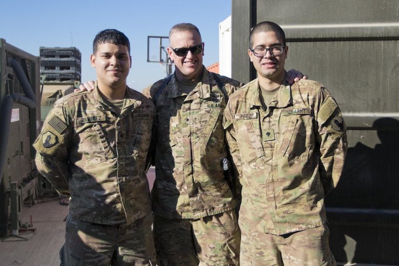Brig. Gen. Robert D. Harter, deputy commanding general of the 1st Sustainment Command (Theater) / commanding general of the 316th Sustainment Command (Expeditionary), (center), poses with Spc. Brian Ramirez, (left), and Spc. Jose Perez, (right), both mortuary affairs specialists with the 246th Quartermaster Company (Mortuary Affairs), an U.S. Army Reserve unit based out of Mayaguez, Puerto Rico, in Erbil, Iraq on February 3, 2017.
