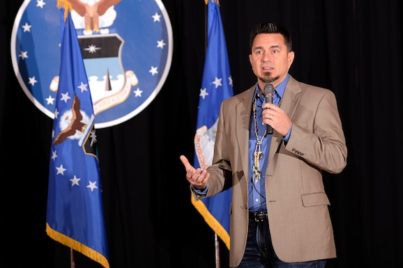 """D.J. """"Eagle Bear"""" Vanas, a motivational speaker and member of the Odawa Nation, speaks to cadets and staff Feb. 16, 2017 at the Prayer Lunch hosted by the U.S. Air Force Academy. Vanas, a 1993 graduate of the Academy, spoke about the importance of accepting the spiritual practices of others and how a spiritual belief system can lead to holistic growth. (U.S. Air Force photo/Mike Kaplan)"""