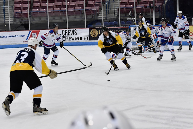 Members of the Charleston Patriots and the Charleston Enforcers skate during the 3rd Annual Matuskovic Charity Hockey Game at the North Charleston Coliseum & Performing Arts Center, Feb. 18, 2017. The game is played in memory of Joe Matuskovic, Charleston County Sherriff's deputy, and other service members and first responders killed in the line of duty.  Members of the Charleston Patriots are from Joint Base Charleston while members of the Charleston Enforcers are from the Charleston County Sheriff's office and fire department.The Charleston Enforcers won the game with a final score of 10-2.