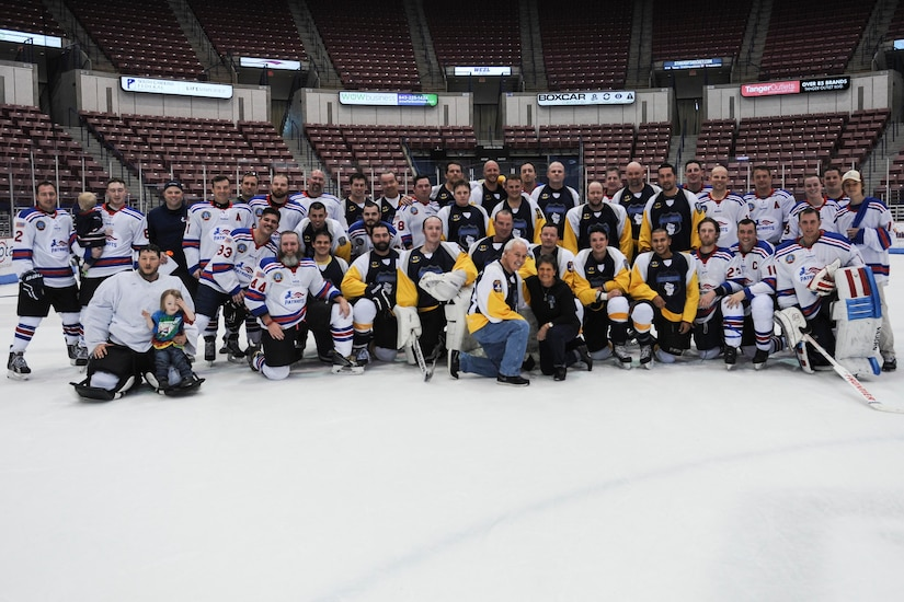 The Charleston Patriots and the Charleston Enforcers pose for a photo after the 3rd Annual Matuskovic Charity Hockey Game at the North Charleston Coliseum & Performing Arts Center, Feb. 18, 2017. The game is played in memory of Joe Matuskovic, Charleston County Sherriff's deputy, and other service members and first responders killed in the line of duty. Members of the Charleston Patriots are from Joint Base Charleston while members of the Charleston Enforcers are from the Charleston County Sheriff's office and fire department. The Charleston Enforcers won the game with a final score of 10-2.