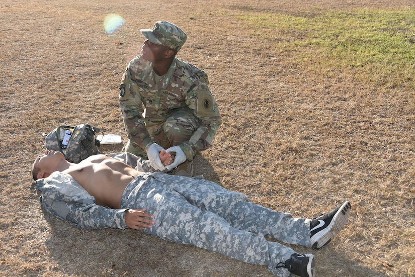 After a recent post-wide competition among six servicemembers, Army Staff Sgt. Otis Bostic, Supply NCO, represents the Army as the named NCO of the 2nd Quarter for JTF-Bravo. Bostic is pictured performing medical readiness tasks as part of the board competition.