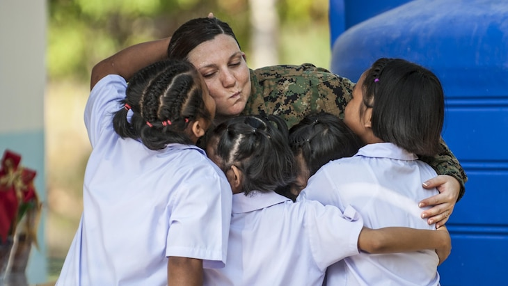 Navy Petty Officer 1st Class Samantha Clark bids farewell to Thai students after a school project in Rayong province, Thailand, Feb. 21, 2017. Navy photo by Petty Officer 2nd Class Markus Castaneda